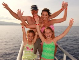 Family with two small kids on the bow of the Pride of Maui