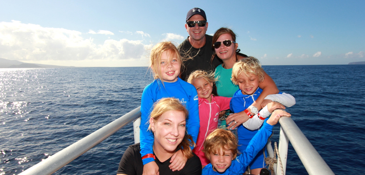 A big family on the bow of the Pride of Maui boat.