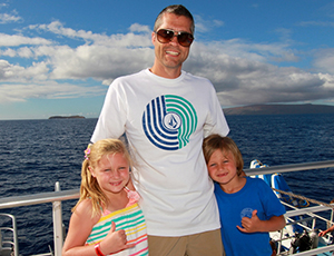 Father with son and daughter on a snorkel cruise.