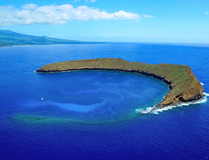 Molokini Crater with the island of Maui in the background