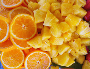 Platter of sliced oranges and pineapple cubes