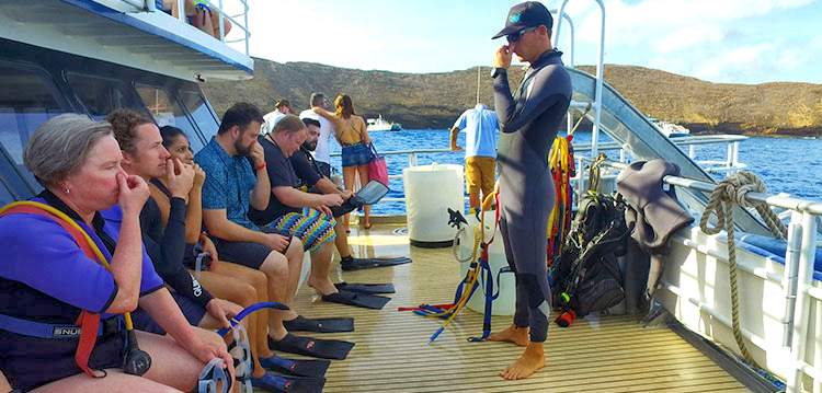 Instructor explaining safety to a group on the Pride of Maui.