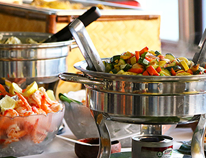 heated containers serving mixed vegetables and a bowl of shrimp and lemon