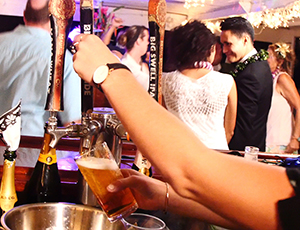 Bartender serving beer from the tap