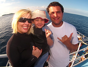mother and father with their toddler on the Pride of Maui boat.