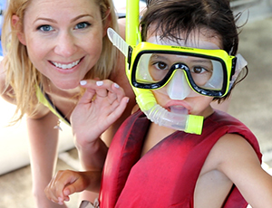 Woman her toddler in snorkel mask